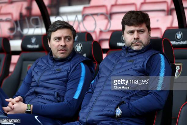 Miguel D'Agostino Tottenham Hotspur coach and Mauricio Pochettino Manager of Tottenham Hotspur speak on the bench prior to the Premier League match...