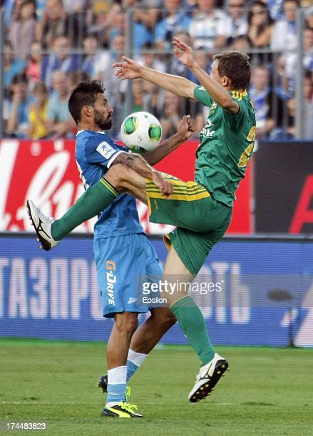 Miguel Danny of FC Zenit St Petersburg and Aleksei Kozlov of FC Kuban Krasnodar vie for the ball during the Russian Premier League match between FC...