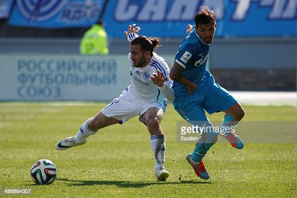Miguel Danny of FC Zenit St. Petersburg and Artur Sarkisov of FC Volga Nizhny Novgorod vie for the ball during the Russian Football League...