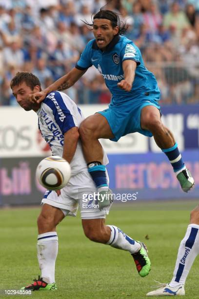 Miguel Danny of FC Zenit St. Petersburg competes for the ball with Aleksandr Shulenin of FC Sibir Novosibirsk during the Russian Football League...