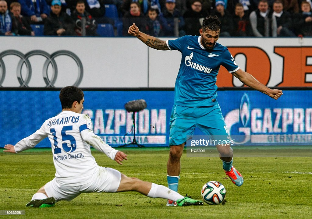 Miguel Danny of FC Zenit St. Petersburg (R) vies for the ball with Ibragim Tsallagov of PFC Krylia Sovetov Samara during the Russian Football League Championship match between FC Zenit St. Petersburg and FC Krylia Sovetov Samara at the Petrovsky stadium on March 24, 2014 in St. Petersburg, Russia.