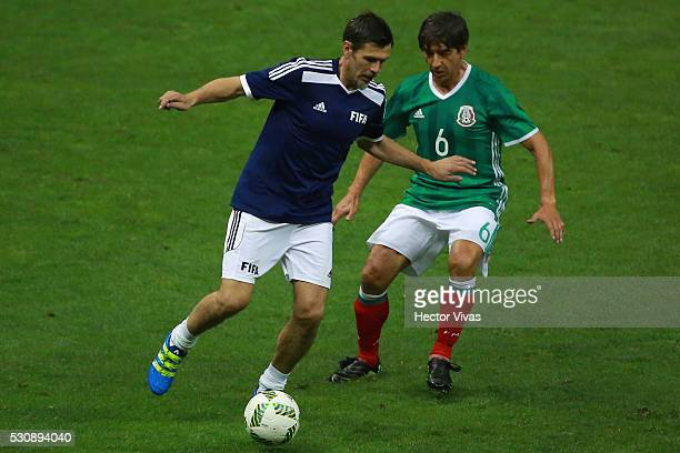 Miguel España of Mexico's All Star Team struggles for the ball with Zvonivir Boban of FIFA Football Legends during the FIFA Football Legends Match...