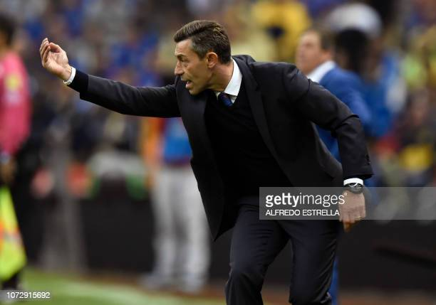 Miguel Faria coach of Cruz Azul gestures during the first round of final of the Mexican Apertura tournament football match at the Azteca stadium on...