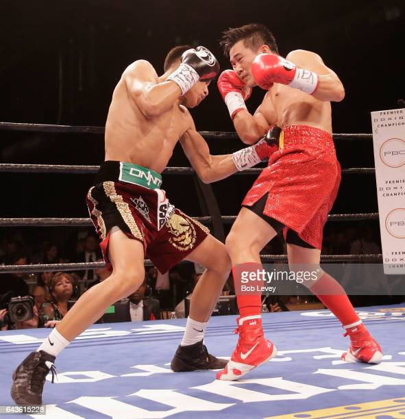 Miguel Flores left connects with a punch to the the abdomen of Dat Nguyen during their super featherweight match at Silver Street Studios on February...