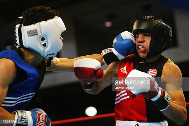Miguel Gonzalez lands a punch in his bout against Victor Ortiz in the United States Olympic Team Boxing Trials at Battle Arena on February 19 2004 in...