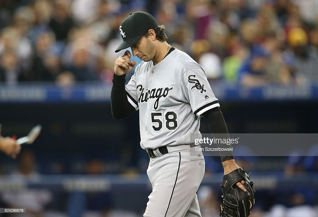 Miguel Gonzalez #58 of the Chicago White Sox exits the game as he is relieved in the sixth inning during MLB game action against the Toronto Blue Jays on April 25, 2016 at Rogers Centre in Toronto, Ontario, Canada.