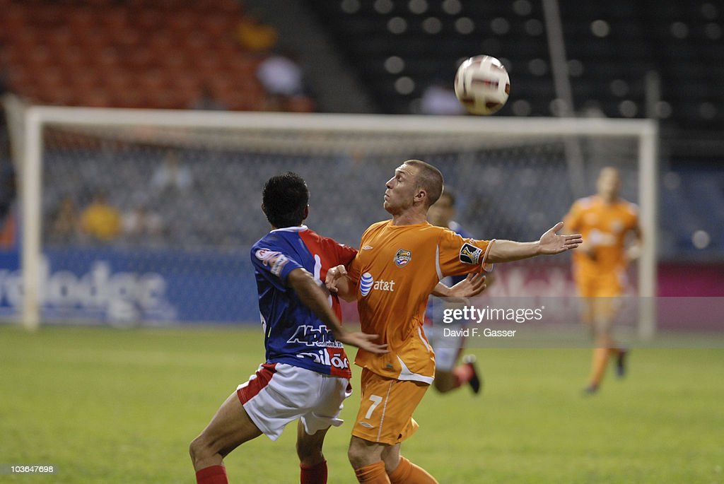 Miguel Granadino (L) of FAS vies the ball with David Foley of Islanders during their match as part of 2010 CONCACAg Champions League at Juan Ramon Loubriel Stadium on August 25, 2010 in Baymon, Puerto Rico.
