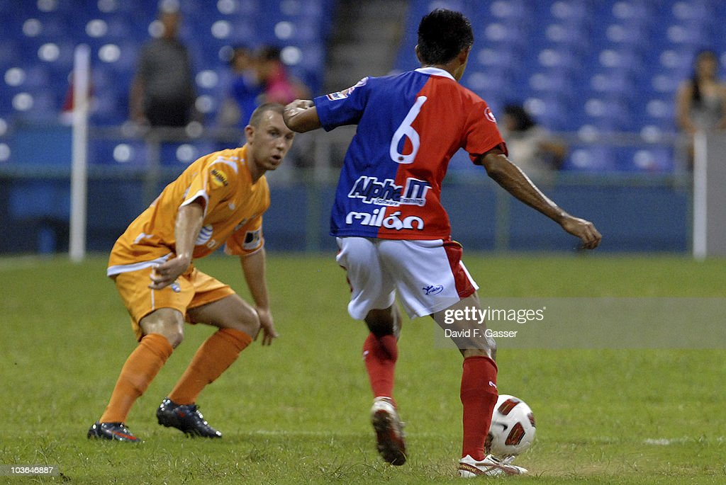 Miguel Granadino of FAS vies the ball with player of Islanders during their match as part of 2010 CONCACAg Champions League at Juan Ramon Loubriel Stadium on August 25, 2010 in Baymon, Puerto Rico.