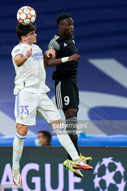 Miguel Gutierrez of Real Madrid battle for the ball Adama Traore of FC Sheriff during the UEFA Champions League group D match between Real Madrid and...