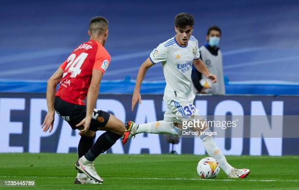 Miguel Gutierrez of Real Madrid CF and Hoppe of RCD Mallorca battle for the ball during the LaLiga Santander match between Real Madrid CF and RCD...