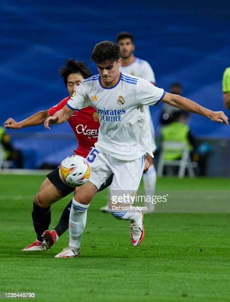 Miguel Gutierrez of Real Madrid CF and Kang in Lee of RCD Mallorca battle for the ball during the LaLiga Santander match between Real Madrid CF and...
