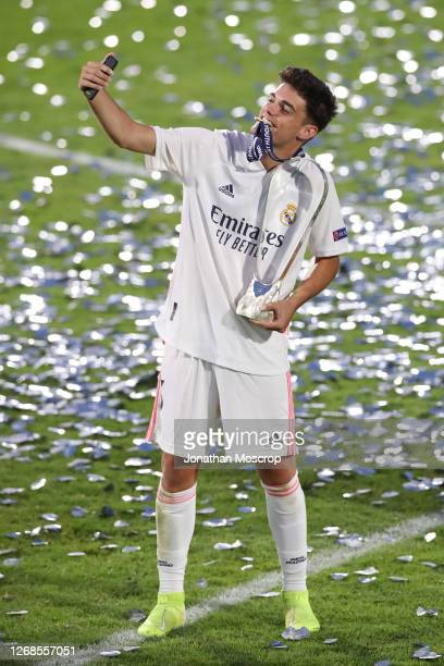 Miguel Gutierrez of Real Madrid takes a selfie as he poses with the trophy following the match at Colovray Sports Centre on August 25, 2020 in Nyon,...