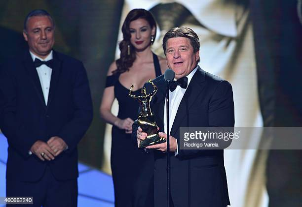 Miguel Herrera accepts award onstage at the inaugural Premios Univision Deportes backstage at Univision Studios on December 18 2014 in Miami Florida