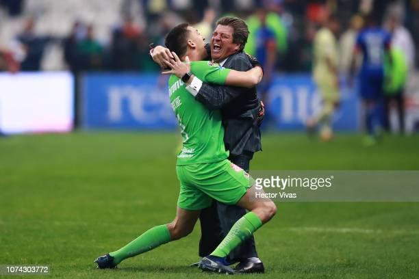 Miguel Herrera coach of America celebrates with Agustin Marchesin of America during the final second leg match between Cruz Azul and America as part...