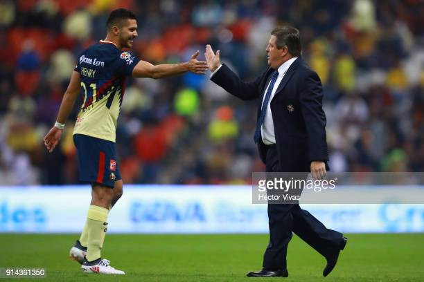 Miguel Herrera Coach of America celebrates with Henry Martin of America after the 5th round match between America and Lobos BUAP as part of the...