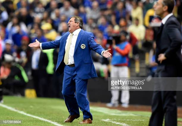 Miguel Herrera coach of America gestures during the first round of final of the Mexican Apertura tournament football match at the Azteca stadium on...