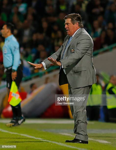 Miguel Herrera coach of America gives instructions to his players during the 17th round match between Santos Laguna and America as part of the Torneo...