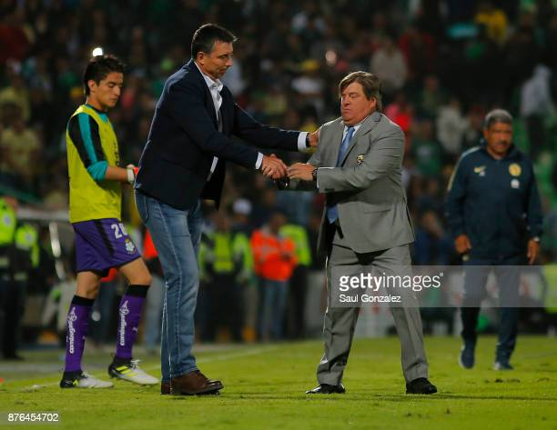 Miguel Herrera coach of America greets Robert Siboldi coach of Santos during the 17th round match between Santos Laguna and America as part of the...