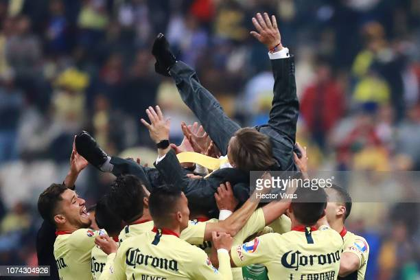 Miguel Herrera Coach of America is hoisted in the air by players the final second leg match between Cruz Azul and America as part of the Torneo...