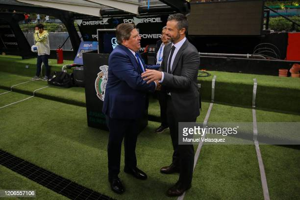 Miguel Herrera coach of America shake hands with Rafael Puente coach of Atlas prior the 6th round match between America and Atlas as part of the...