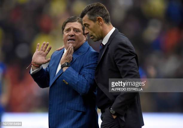 Miguel Herrera coach of America speaks with Miguel Faria of Cruz Azul after the first round of final of the Mexican Apertura tournament football...