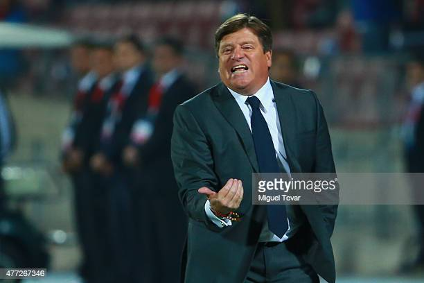 Miguel Herrera coach of Mexico gives instructions to his players during the 2015 Copa America Chile Group A match between Chile and Mexico at...