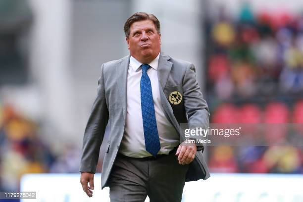 Miguel Herrera Head Coach of America walks through the field during the 13th round match between Cruz Azul and America as part of the Torneo Apertura...