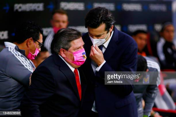 Miguel Herrera , Head Coach of Tigres talks with Santiago Solari , Head Coach of America during the 15th round match between America and Tigres UANL...