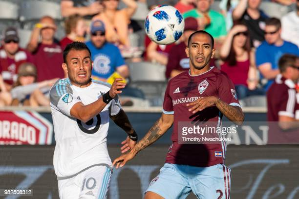 Joe Mason of Colorado Rapids scores over Bobby Shuttleworth of Minnesota United at Dick's Sporting Goods Park on June 23 2018 in Commerce City...