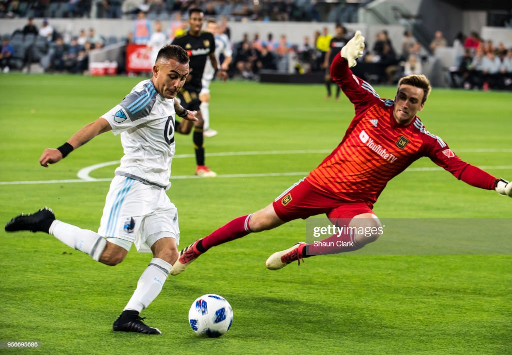 Miguel Ibarra #10 of Minnesota United gets past Tyler Miller #1 of Los Angeles FC during Los Angeles FC's MLS match against Minnesota United at the Banc of California Stadium on May 9, 2018 in Los Angeles, California. Los Angeles FC won the match 2-0