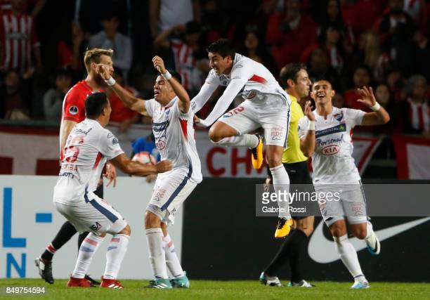Miguel Jacquet of Nacional celebrates with teammates after scoring the first goal of his team during the second leg match between Estudiantes and...