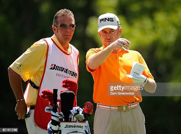 Miguel Jimenez of Spain and caddie Paul Smith look over the yardage on the 3rd hole during the third round of the WGCBridgestone Invitational at...