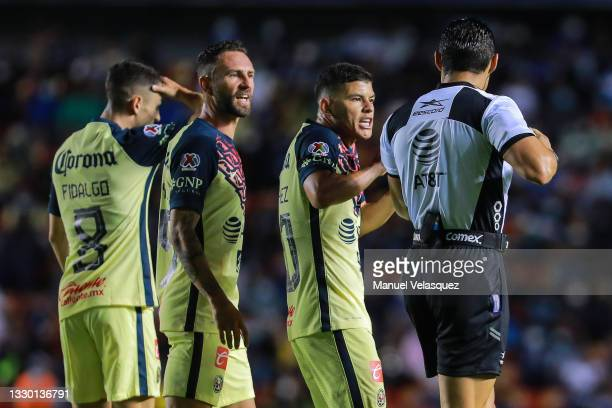 Miguel Layún and Richard Sánchez of America argue with Marco Antonio Ortiz, referee, during the 1st round match between Queretaro and America as part...