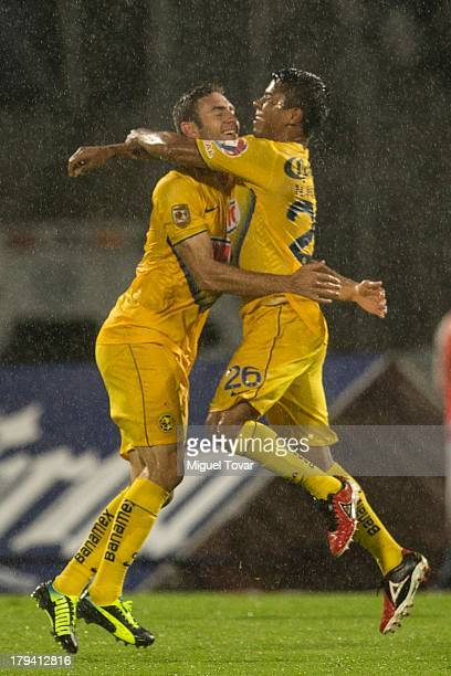 Miguel Layun and his teammtes of America celebrate a goal against Pumas during a match between Pumas and America as part of the Apertura 2013 Liga MX...