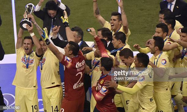 Miguel Layun and teammates of America celebrate with the trophy of the Mexican Apertura tournament at the Azteca stadium on December 14 in Mexico...