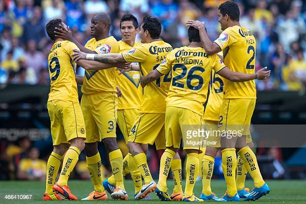 Miguel Layun celebrates after scoring with teammates during a match between America and Atlante as part of the Clausura 2014 Liga MX at Azteca...
