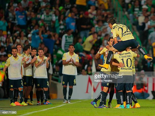 Miguel Layun celebrates with teammates after scoring the second goal of the match during a match between Santos Laguna and America as part of 10th...