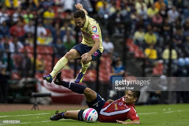 Miguel Layun of America fights for the ball with Adrian Cortes of Veracruz during a match between America and Veracruz as part of 11th round Apertura...