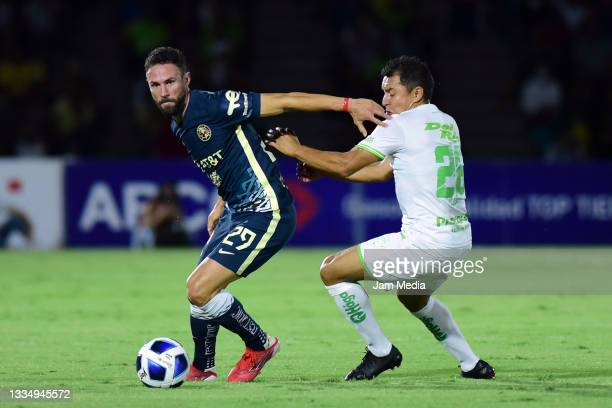 Miguel Layun of America fights for the ball with Omar Antonio Panuco of Juarez during the 5th round match between FC Juarez and America as part of...