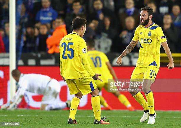 Miguel Layun of FC Porto celebrates scoring his team's first goal with his team mate Otavio during the UEFA Champions League Group G match between...