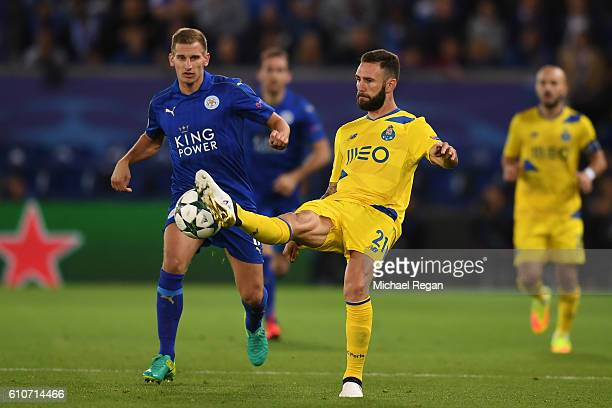 Miguel Layun of FC Porto is watched by Marc Albrighton of Leicester City during the UEFA Champions League Group G match between Leicester City FC and...
