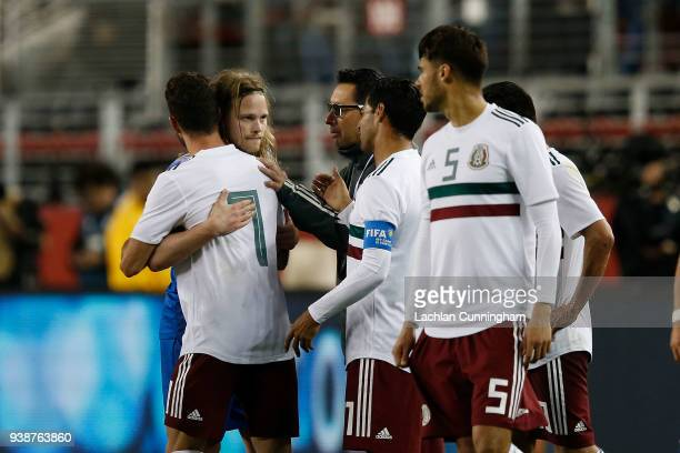 Miguel Layun of Mexico and Birkir Bjarnason of Iceland hug after the two had an altercation during their match at Levi's Stadium on March 23 2018 in...