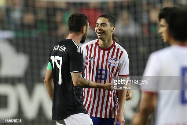 Miguel Layun of Mexico and Miguel Almiron of Paraguay argue during the friendly match between Paraguay and Mexico at Levi's Stadium on March 26 2019...