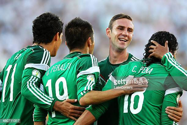 Miguel Layun of Mexico celebrates Oribe Peralta's goal during leg 2 of the FIFA World Cup Qualifier match between the New Zealand All Whites and...