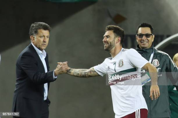 Miguel Layun of Mexico celebrates with Juan Carlos Osorio after scoring the second goal of his team during the friendly match between Mexico and...