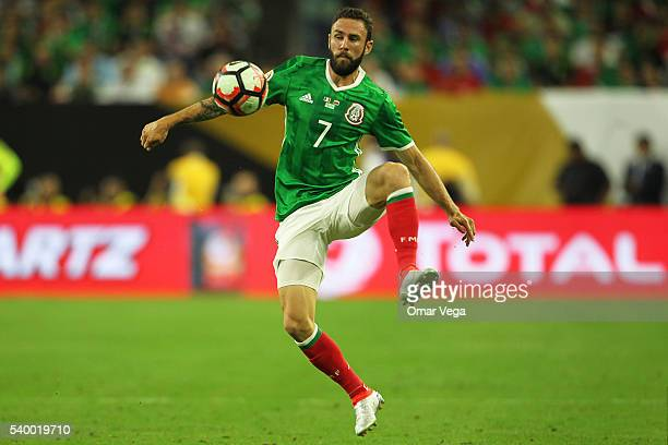 Miguel Layun of Mexico controls the ball during a group C match between Mexico and Venezuela at NRG Stadium as part of Copa America Centenario US...