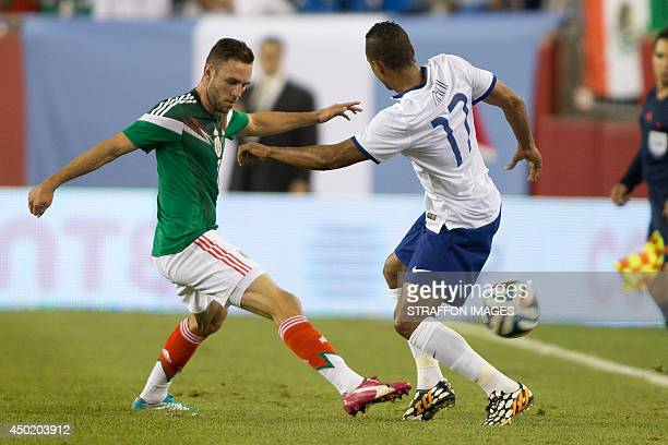 Miguel Layun of Mexico defends against Nani of Portugal during the Internatinal friendly match between Mexico and Portugal at Gillette Stadium on...