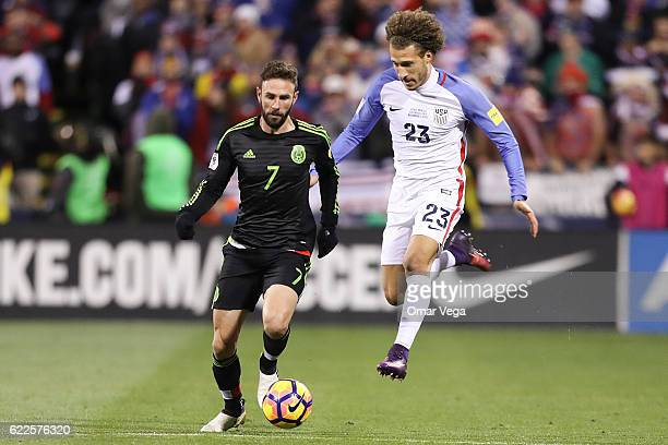 Miguel Layun of Mexico fights for the ball with Fabian Johnson of USA during the match between USA and Mexico as part of FIFA 2018 World Cup...