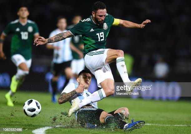 Miguel Layun of Mexico fights for the ball with Leandro Paredes of Argentina during a friendly match between Argentina and Mexico at Mario Kempes...