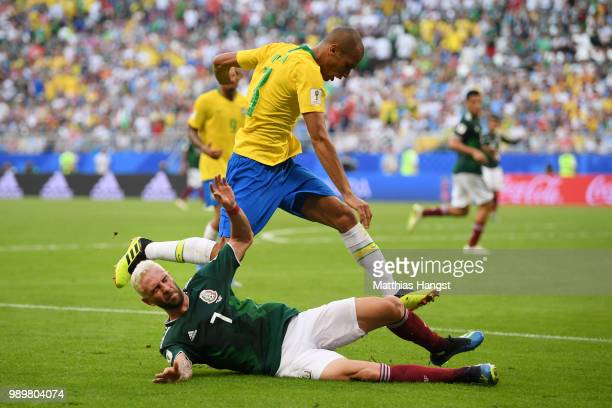 Miguel Layun of Mexico is tackled by Miranda of Brazil during the 2018 FIFA World Cup Russia Round of 16 match between Brazil and Mexico at Samara...